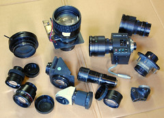 Lenses Galore (01) (Hans Kerensky) Tags: yellow lens mirror tv angle projector 10 14 85mm cine philips 100mm 300mm xray 100 mm 12 18 lcd sbc teleconverter m25 lenses viewfinder schneider 118 kowa zoomlens combined 10x10 loupe rodenstock 88mm gmbh 5310 reichmann wideconverter x07 94130 variogon x145 94292 xrheligon cmount 150300mm serialnr feinoptik tvheliflex