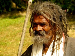 A face marked by life (Linda DV (away)) Tags: travel portrait people india face canon geotagged temple beggar assam 2008 sevensisters sivasagar sibsagar 7sisters northeastindia powershots5is lindadevolder sivadol