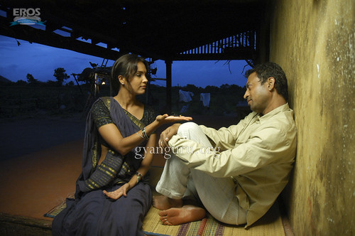 Irrfan Khan and Lara Dutta in a scene from Billu Barber