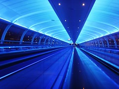Long Blue Tunnel (Tony Worrall) Tags: uk blue england lines manchester lights airport angle walk north tunnel terminal walkway lit northern manchesterairport