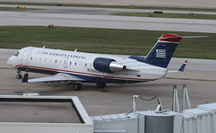 US AIRWAYS EXPRESS, Bombardier CRJ-200ER, N206PS, at CRW, Yeager Airport, Kanawha Regional, Charleston, West Virginia, USA. July, 2009 (Tom Turner - SeaTeamImages / AirTeamImages) Tags: city usa white tarmac plane airplane airport wings ramp gate unitedstates aircraft aviation transport wing jet spot passengers charleston westvirginia engines transportation airline pax express passenger airways winglet airlines carrier regional spotting airliner jetplane crw crj usairways winglets yeager bombardier fuselage taxiway regionaljet kanawha chuckyeager crj200 tomturner usairwaysexpress crj200er n206ps