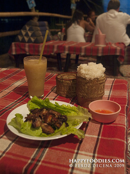 Riverside Resto Ping Gai (18000 Kip), Mixed Fruit (7000 Kip), Sticky Rice (4000 Kip)