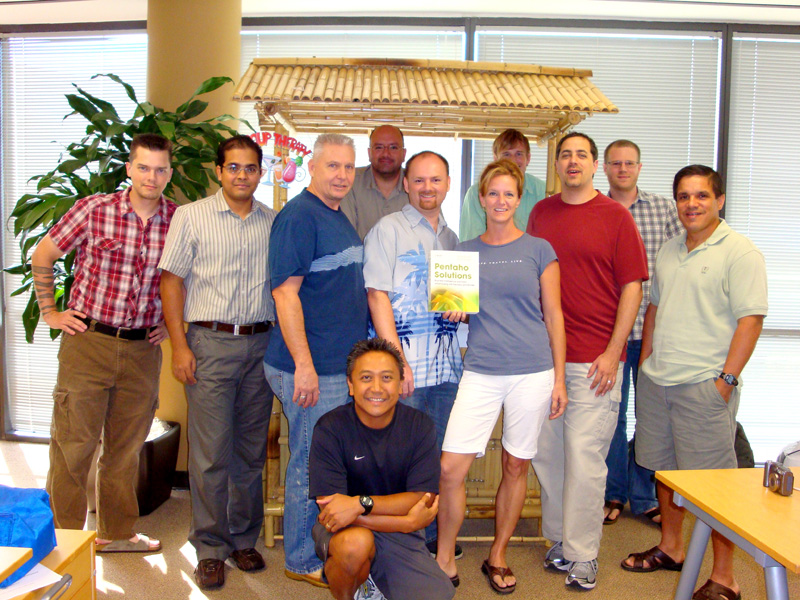 "Pentaho corp. posing with a copy of ""Pentaho Solutions"""