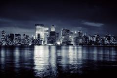 the gotham blues (mudpig) Tags: nyc newyorkcity reflection skyline night geotagged jerseycity cityscape worldtradecenter financialdistrict hudsonriver hdr mudpig stevekelley