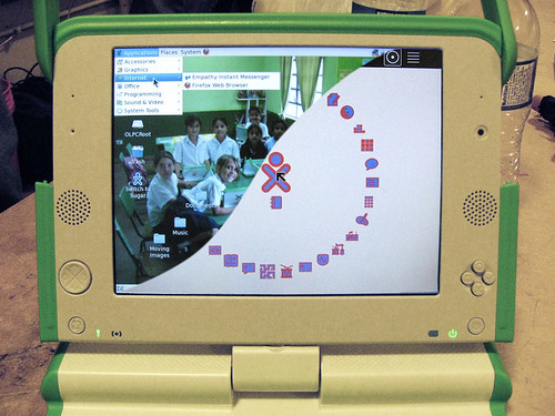 Photo-composite of Gnome and Sugar running on a prototype OLPC XO-1.5 laptop
