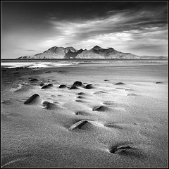 Monochromatic Dawn on Eigg (Ally Mac) Tags: uk mountains beach rural sunrise canon landscape island islands bay scotland rocks innerhebrides britain stones scottish lee rum polarizer 06 grad 1022 cpl firstlight eigg goldenlight laig leadin smallisles 40d boyoflaig