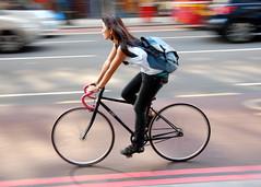 Whitechapel Road (jeremyhughes) Tags: road street blue woman motion blur london bike bicycle speed fix cycling movement nikon cyclist traffic zoom longhair explore singlespeed fixed fixie fixedgear earrings nikkor kiwi panning whitechapel whitechapelroad vr messengerbag courierbag redlines 18200mm d40 jeremyhughes bluebike fixedwheel