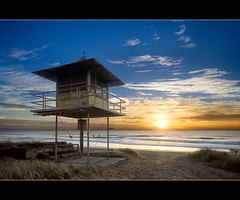 lifeguard hut (Pawel Papis Photography) Tags: ocean morning blue sea sky sun seascape beach water yellow clouds sunrise sand raw angle wide wave australia wideangle lifeguard calm minimal hut qld queensland mermaid dri goldcoast pawel broadbeach lifeguardhut sigma1020 mermaidbeach 13mm 3exposures canon400d entrytobeach