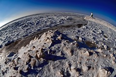 A small planet (rexp2) Tags: winter sky usa lighthouse ice water mi harbor pier lakemichigan greatlakes handheld southhaven appleaperture nikkorfisheye105mmf28 afdxfisheyenikkor105mmf28ged nikond300 nikkor105mmf28gedafdxfisheyenikkor