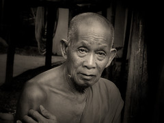 Live a simple and meditative life (Bn) Tags: nirvana monk laos enlightenment enlightened buddhistmonks theravada lifeispain  teachingsofthebuddha meditativelife buddhisminlaos spiritalpractise elderlymonk monkattemple portraitofalaomonk laomonk friendlymonk honestyandsincerity bendespammer bendeexploremanipulatorzuljebedoelen