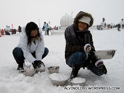 Adults making snowmen