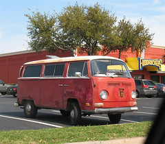 Rough Red Bay Window VW Bus in Austin, Texas - Passenger Side Front View