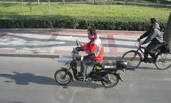 Texting in Beijing China (pscf11) Tags: china street shadow red cold bike bicycle message phone text beijing cell riding gloves motorcycle moped texting messaging universityofmaryland pinterest