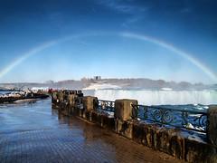 Niagara Falls Full Rainbow (draculesti27) Tags: blue mist snow newyork ontario canada ice wet water niagarafalls waterfall rainbow olympus bleu neige grille railing cascade brume glace arcenciel horseshoefalls evolt niagarariver leau e500 chutesduniagara lachutedufercheval