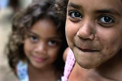 Something brewing... (carf) Tags: poverty girls light brazil portrait girl beauty brasil kids children hope kid community support child risk naturallight forsakenpeople esperana social impoverished underprivileged afrobrazilian altruism angels shanty brazilian hummingbirds beijaflor favela development prevention stefanie anjos atrisk tamiris mundouno stiojoaninha