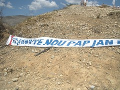 Large banner, in Creole. Translation? (leastlikely) Tags: cemetery haiti memorial massgrave taphophilia haitiearthquake