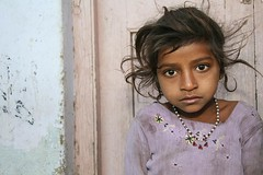 Girl in front of her house... (Asia - India) (RURO photography) Tags: voyage travel girls portrait people india girl beautiful smile face female canon fun photography reisen asia faces photos culture reis nios nia kind portraiture lonelyplanet criana ethnic portret indi anthropology arquitecture gujarat reise inde independant cultuur reizen discoverychannel azi olddoors gesichter supershot kartpostal nationalgeography enstantane indigenoustribal voyageursdumonde overtheexcellence naturalbeautyportraiture tourisism globalbackpackers discoveryphoto discoveryexpeditions rudiroels thegalleryoffineportrait fadingcultures ethnograaf ethnografisch culturasperdidas verdwenenculturen