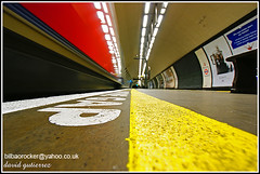 London Underground: Mind the Gap !... (david gutierrez [ www.davidgutierrez.co.uk ]) Tags: life city uk travel blue wedding light red england urban color colour london art colors lines yellow architecture modern train underground person photography mirror interestingness cityscape colours searchthebest metro unitedkingdom walk sony transport tube perspective platform double explore londonunderground alpha clapham claphamcommon soe thetube streaming mindthegap municipality transportforlondon londonengland blueribbonwinner thelondonunderground supershot lowview aupaathletic conceptimage sonyalpha thanksyou mywinners platinumphoto aplusphoto claphamcommontubestation theunforgettablepictures theunforgettablepicture theperfectphotographer goldstaraward theenchantedcarousel sonyalphadslra350 flickr:user=davidgutierrez2007 londonundergroundlifecolor sonyalphadslr350 qualitysurroundings sonyalphadt1118mmf4556lens sony350dslra350