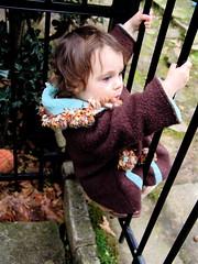 Hangin' (spinadelic) Tags: winter girl rock kids fence children march backyard toddler little coat hanging arkansas hang 2009 stevespencer
