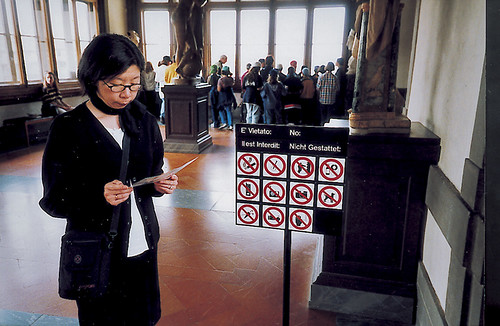 Pammy studies the cryptic signage at the Uffizzi