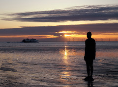 Iron man to Isle of Man (Mr Grimesdale) Tags: sunset reflection beach silhouette statue liverpool olympus mersey gormley crosby antonygormley merseyside e510 anotherplace rivermersey gapc mrgrimsdale stevewallace gormleystatue europeancapitalofculture2008 mrgrimesdale