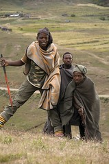 Lesotho, Africa -  3 Shepherds in the mountains (Marie-Marthe Gagnon) Tags: africa portrait sky mountains men portraits shepherd expression young kingdom icon 300 20 blankets sheeps famine lesotho shepherds drakensberg blueribbonwinner posterproject bergers 20f drakensbergmountains flickrchallengegroup flickrchallengewinner kingdominthesky drakenburg drakenburgmountains geoafrica mariegagnon mariemarthegagnon