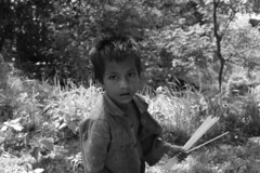 Village boy (TrustedSign) Tags: boy blackandwhite poor straw bangladesh proverty moheshkhali