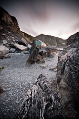 Tackle house, Lundy Island, UK (jogorman) Tags: uk sunset england sky house southwest english beach speed island nikon rocks long exposure slow unitedkingdom shingle shoreline sigma pebbles devon filter shore nd shutter nikkor 1020mm filters grad 1020 isle lundy tackle graduated density devonshire cokin d3x neurtal