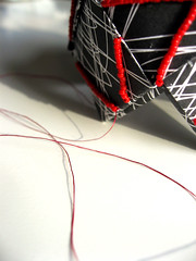 Scribble PETALI (frucci) Tags: shadow red white black glass thread paper beads workinprogress jewelry folded scribble recycledpaper redthread emboridery fruccidesign