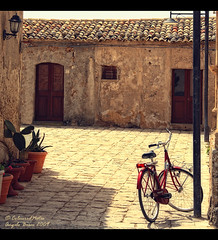 Aesthetics of Quietness (Marzamemi - Sicilia) (Angelo Bosco) Tags: summer bicycle estate courtyard silence sicily soe pathway marzamemi sicilia quietness cortile bicicletta tranquillity silenzio blueribbonwinner tranquillit abigfave anawesomeshot theunforgettablepictures overtheexcellence goldstaraward colourednotes angelobosco