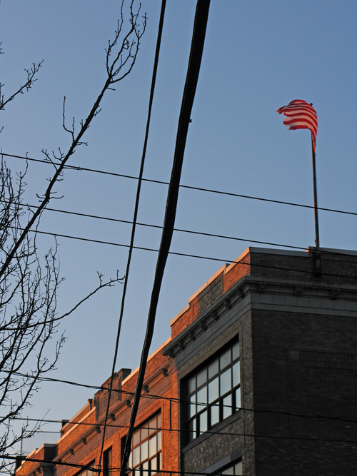 a flag flaps at sunset, Jersey City, New Jersey, NJ