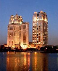 "Cairo ""Twin towers"". (Marwa Morgan) Tags: africa blue light building water skyline architecture night river landscape lights nikon egypt vivid nile cairo egyptian nightshots egitto egypte afrique d40 lecaire nikor1855 1855mmf3556gii gettyimagesmeandafrica1"
