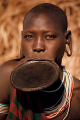 Africa - Ethiopia / Mursi woman (RURO photography) Tags: voyage travel portrait tourism beautiful smile face female canon photography necklace mujer pretty faces photos retrato femme mulher cara reis tourist portraiture lip portret mursi scarification afrique reizen omo africaine etiopia gesichter stmme ethnique tribue omorate kartpostal fun lipplate enstantane etipia etiyopya anawesomeshot journalistchronicles  supershot globalbackpackers lonelyplanet discoveryphoto discoverychannel discoveryexpeditions voyageursdumonde nationalgeographic inspiredelite mursiwoman rudiroels thegalleryoffineportrait lipschijf