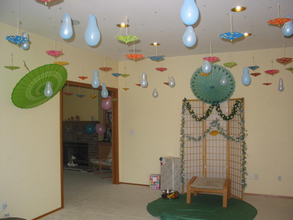 The decoration: blue baloons are the water drops and then the umbrellas - 'shower' theme!