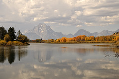 Mt. Moran in Autumn (bhophotos) Tags: travel usa mountains nature water clouds reflections river landscape nikon fallcolors autumncolors snakeriver wyoming hazy tetons nationalparks oxbow grandtetonnationalpark d300 oxbowbend mtmoran
