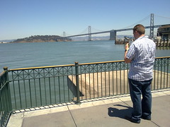 Jonny Bruha sees Treasure Island and Bay Bridge from Ferry Building