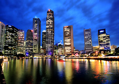 Singapore City Lights (` Toshio ') Tags: city longexposure tourism water architecture night buildings reflections river lights harbor boat singapore neon cityscape nightshot restaurants financialdistrict cbd bluehour boatquay raffles centralbusinessdistrict singaporeriver toshio abigfave superaplus theunforgettablepictures raffleslandingsight