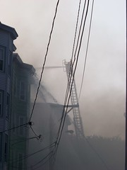 Smoke is slowly clearing (Sam T (samm4mrox)) Tags: morning fire chaos smoke maine disaster damage unexpected firefighters lewiston disasters kodakz8612