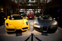 Ferrari Enzo & Bugatti Veyron (erdero) Tags: red yellow silver spider monterey auction ferrari enzo bugatti 2009 veyron rm scaglietti 166 concorsoitaliano 166mm rmauction