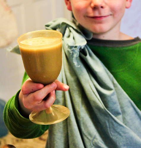 "a happy child with his ""potion"""