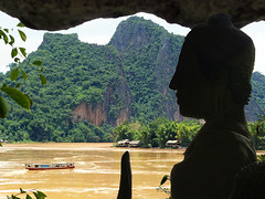 Pak Ou Buddha overlooking the Mekong (Bn) Tags: topf50 nirvana laos longtailboat pilgrims mekongriver pakou 50faves limestonecliffs lowercave pakoucaves limestonemountains thamting namouriver theunforgettablepictures thamtheung upstreamfromluangprabang laostylebuddhasculpture 2500buddhas