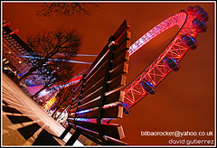 London Eye & a Bench with a View at Night... (davidgutierrez.co.uk) Tags: street city uk greatbritain travel pink light shadow red england urban sculpture reflection building london eye colors yellow thames architecture modern night dark bench spectacular geotagged photography pier interestingness arquitectura cityscape with view darkness riverside unitedkingdom britain dusk walk sony centre cities cityscapes londoneye landmark center icon structure architectural explore nighttime finepix architektur nights sensational metropolis alpha impressive dt offices countyhall nightfall municipality edifice f4556 1118mm sonyalpha sonydslra350 sony1118mm sonyalphadslr350 sonyalphadt1118mmf4556lens sonyalphadt1118mmf4556 sony350dslra350