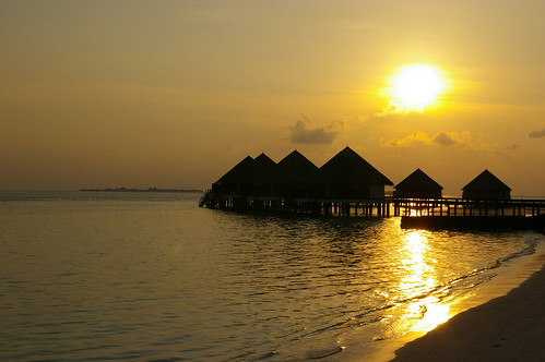 Sunrise over water villas, Meedhupparu Island, Maldives
