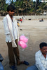 A handicapped man selling cotton candy on Juhu beach.