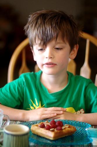 nick having raspberries on vegan sourdough waffles for breakfast - _MG_1786