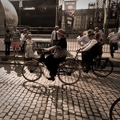 A Sudden Vision of the Past (Gilderic Photography) Tags: street shadow people woman man public bicycle circle lumix costume movement europe raw place belgium belgique belgie femme perspective culture folklore ombre panasonic cobblestone riding chapeau histoire past rue liege 2009 velo barriere luik contrejour cycliste fetes defile pave lightroom wallonie cortege epoque wallonia saintlambert lx3 fetesdewallonie dmclx3