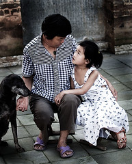 (OperaLove) Tags: holding blackdog asianwoman whitedress blacktrousers lifephoto grayground asianlittlegirl colortshirt
