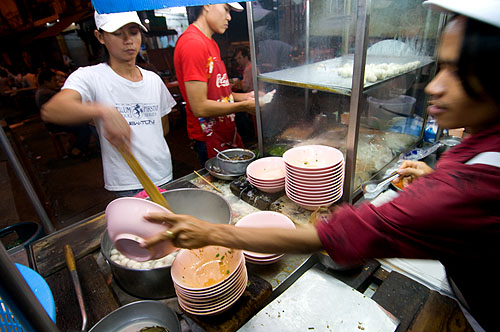 Serving up noodles at Lim Lao Ngow, a noodle stall in Bangkok's Chinatown