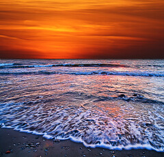 orange sunset (paolo brunetti) Tags: sea sky orange sun beach sand tramonto mare waves alba wave cielo sole livorno shining spiaggia sunsetsunrise onde sabbia tirrenia nuvoloso calambrone nuvolo mywinners