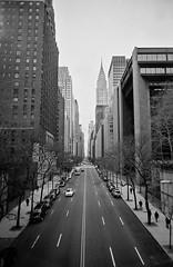 east to west (ho_hokus) Tags: nyc newyorkcity winter blackandwhite bw monochrome skyscrapers manhattan chryslerbuilding 2009 plasticcamera 42ndstreet tudorcity vivitarultrawideslim